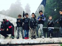 The youngest team with their weapons