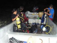 Preparing night diving equipment