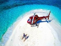 Enjoy the beach arriving by helicopter