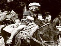 Niños en mulas