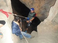 Abseiling into caves