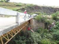 Free fall rappel from bridge