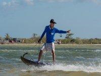 Practicing kite surfing