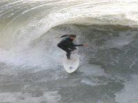 Surfe montando olas