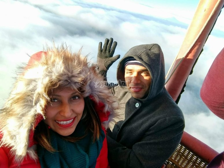 Couple flying in a balloon