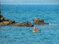 Kayaks on rocky areas