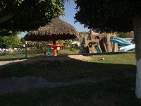 Palapas and playground