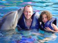 En familia con delfines