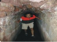 Caving by tunnels