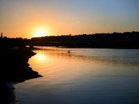 Practice kayaking at sunset
