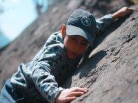 Climbing the rocky wall