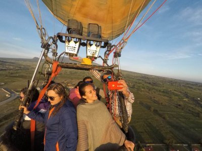 Shared adult balloon flight and toast in Huamantla