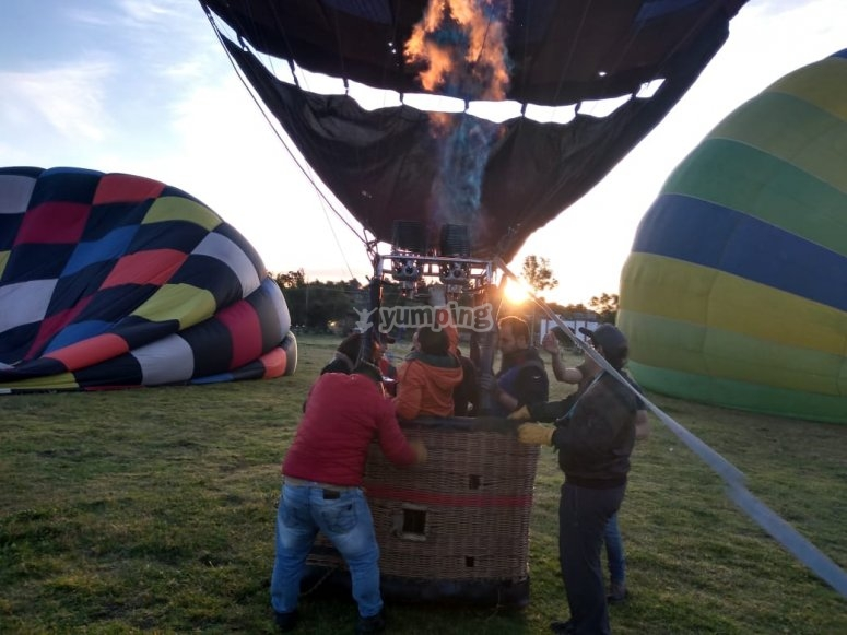 Taking off between more balloons