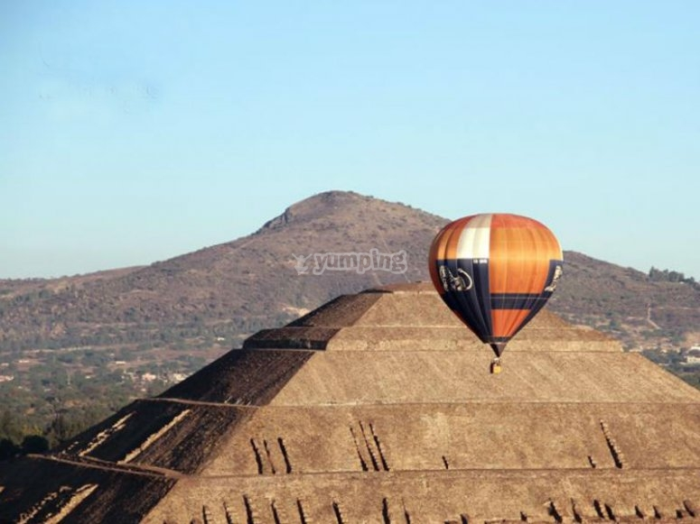 Landscape with balloon and pyramid