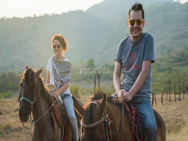 Enjoying horseback riding in the valley