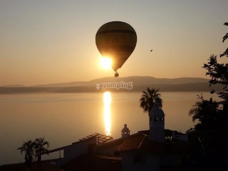 Sunrise in a balloon over the lake