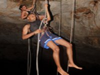 Couples rappelling