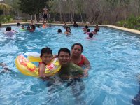 Adults and kids in the pool