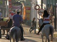 Horseback riding through the town
