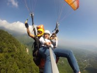 Taking photos during the paragliding flight
