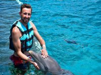 Happy with a dolphin