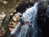 Rappelling in waterfalls