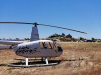 Fly in a helicopter over Valle de Guadalupe