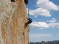Lowering rock wall with rappel