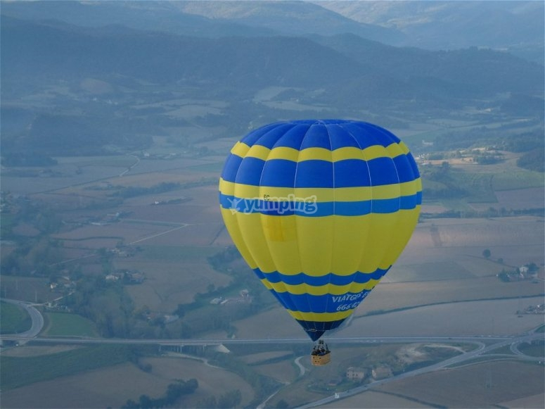 Flying in blue and yellow balloon