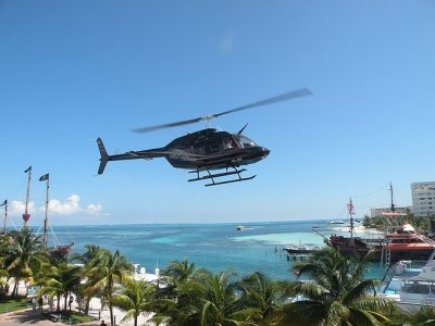 Helicopter flight over Coba and Guided visit