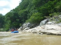 Venturing into the river in rafting