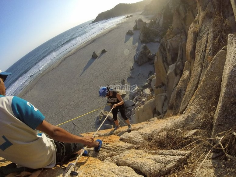 Abseiling in front of the Pacific Ocean