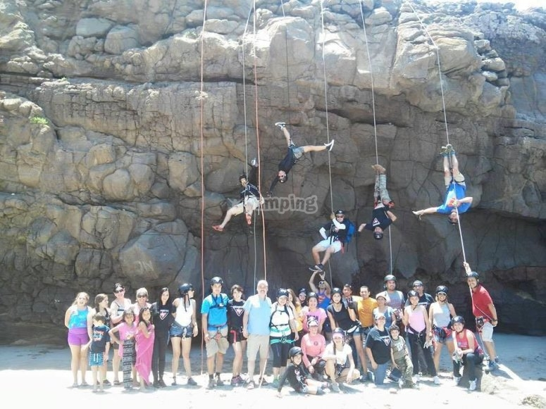 A group of abseiling friends