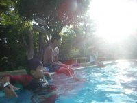 In the pool taking the sun