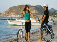 As a couple riding a bicycle