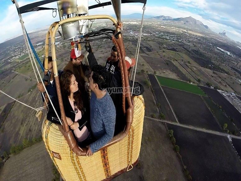 Couples enjoying a balloon ride