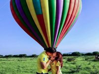 The most waiting kiss in front of the balloon