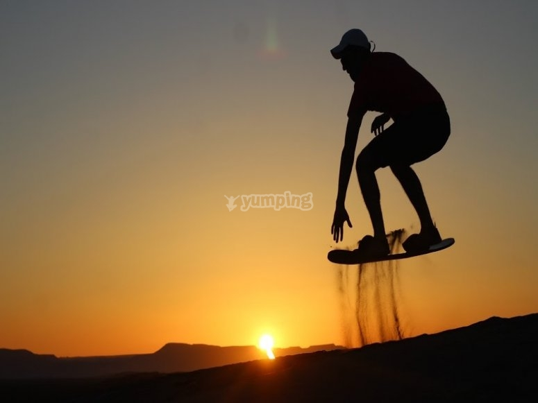 Sandboarding at sunset