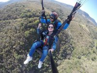 Enjoying paragliding flight