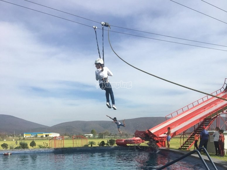 Zip lining over the lake in Puebla