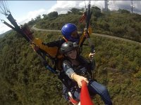 Paragliding girl with monitor