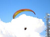 Paragliding with the clouds behind the back