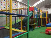 Modular play system and climbing wall