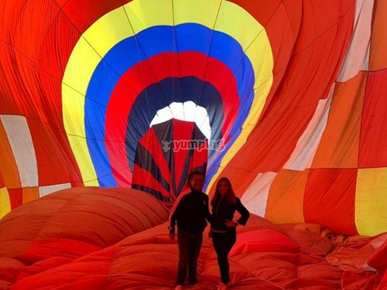 Couple celebrating in balloon flight