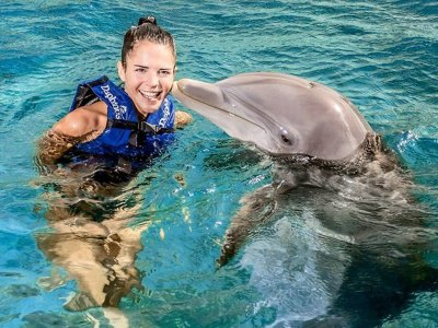 Swim Dolphins Ride and transportation to Xcaret for Children