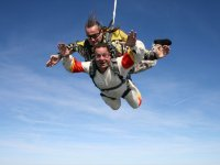 Tandem fall with skydiving monitor
