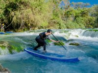 Challenge small rapids with your board paddle