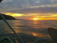 Contempla bellos atardeceres a bordo de nuestro crucero