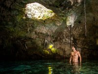 Water caves with sunlight filtering