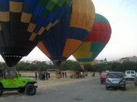 vehículos y globos
